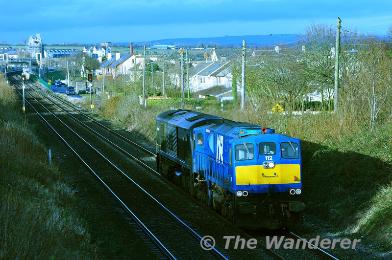 "On Saturday 15th December 2012 112 made a trip to Dublin Connolly to bring failed (8)208 from York Road to Inchicore for repairs. The train is pictured passing the County Bridge in Balbriggan. 112 returned Light Engine to Belfast while 075 brought (8)208 to Inchicore.<br /> <br /> Finnyus also photographed the transfer at Gormanston and it can be viewed at <a href=""http://www.flickr.com/photos/finnyus/8277641247/in/photostream/"">http://www.flickr.com/photos/finnyus/8277641247/in/photostream/</a>"
