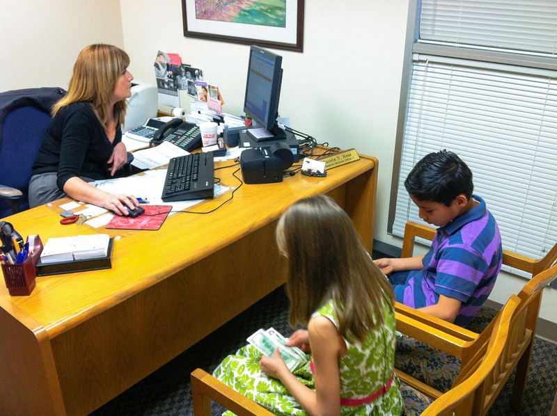 Parker and Stella opening their first bank account at the SECU on Feb. 23, 2012. They are counting their money.