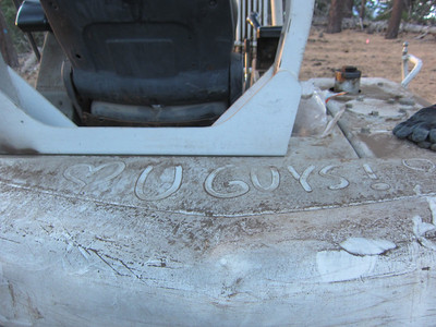 Someone left us a nice note written in the dirt on the back of the excavator!