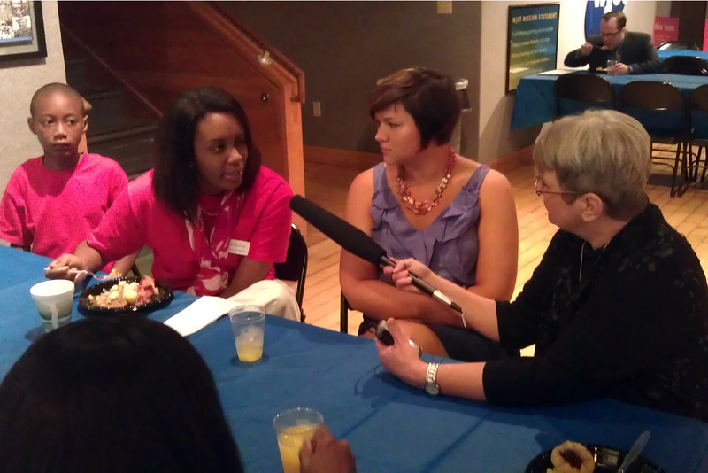 WJCT's Cyd Hoskinson interviews teachers before the Town Hall.