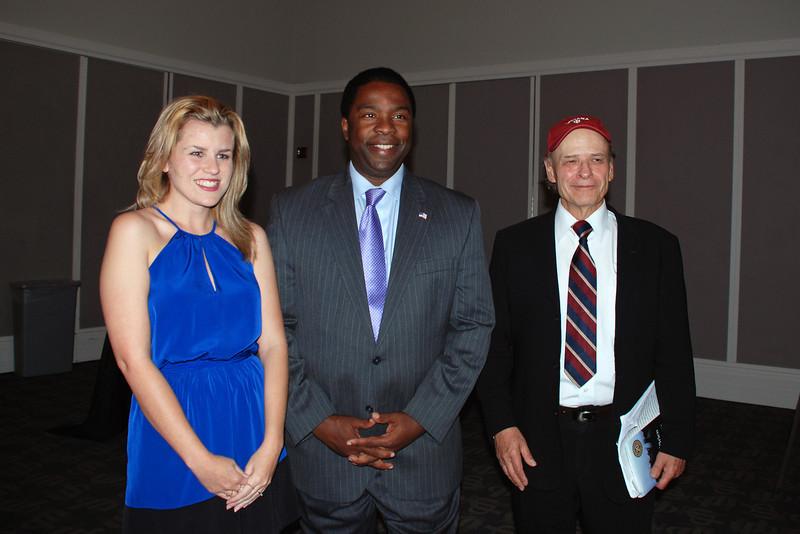 Scholarship Recipient Kelly Milliron, Mayor Alvin Brown, Author Tim O'Brien.