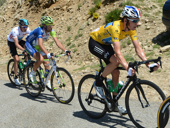 Bradley Wiggins looks on calmly, even though he has Vincenzo Nibali watching him like a hawk...