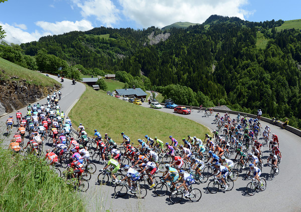 The peloton is almost intact as it starts the climb of the Col de la Colombiére...