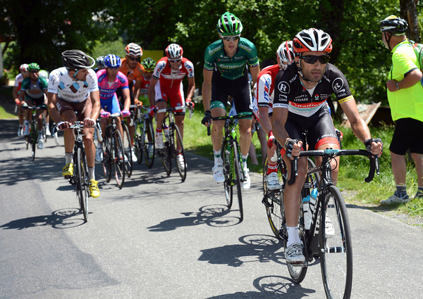 Tiago Machado leads the chasers up the Joux-Plane, but the peloton is catching them really quickly...