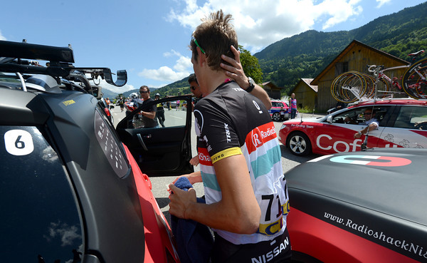 Andy Schleck swaps the broom wagon for his spare team car after abandoning before the final two climbs...