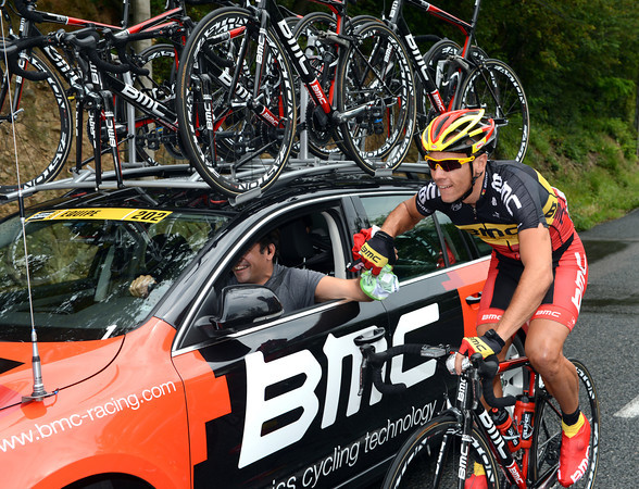 Philippe Gilbert is earning his TDF place by carrying a rain-jacket for Cadel Evans...