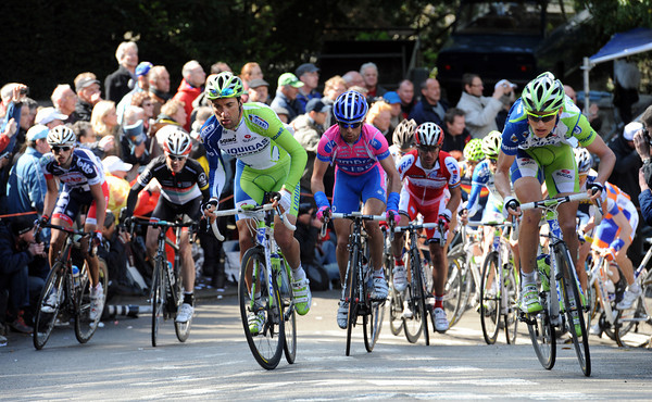 The intact peloton is led by two Liquigas riders on the Mur de Huy...