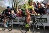 Filippo POzzato leads the chase on the Kemmelberg some four minutes later, with Matthew Hayman marking him...
