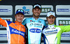 More smiles from Tom Boonen who celebrates alongside Matti Breschel and Peter Sagan...
