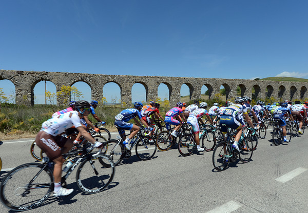 The peloton passes a Roman aqueduct...near Rome...