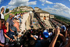 Fans watch as a grupetto climbs into Assisi many minutes later...