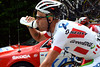 Svein Tuft grabs at a mouthful of water on this hotterst day of the Giro...