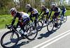 Radio Shack is carrying Frank Schleck back after a bike-change...