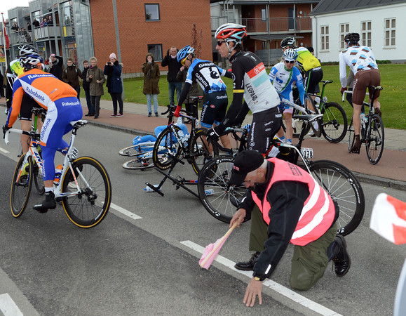 A roadside steward has been sent flying in a collision with some cyclists...