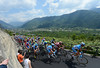The compact peloton climbs the steep ascent of the Teglio, about four minutes down...