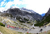 The fourteen chasers are dwarfed completely by the Stelvio ascent...
