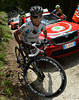 Perget takes to cyclo-cross to get around the car and keep momentum...