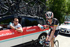 Franck Schleck seems unwell as he collects a water bottle from Kim Andersen...
