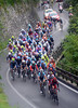 BMC and Gilbert lead the peloton of just 40-or-so riders on the Valcava...
