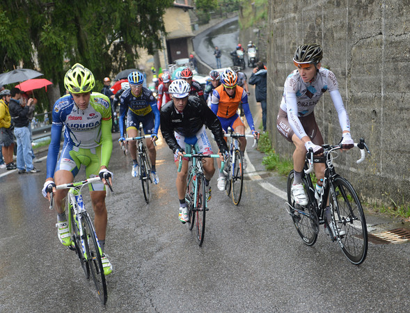 An escape has been allowed to go after a brutal first hour - Christian Salerno leads about twelve riders towards the Valico di Valcava...