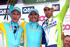 Maxim Iglinsky celebrates an extraordinary victory, with Vincenzo Nibali and Enrico Gasparotto...