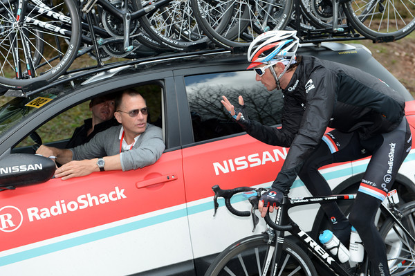 With the peloton sitting up to allow a gap of eleven minutes, Frank Schleck is getting cold - he wants his gloves..!