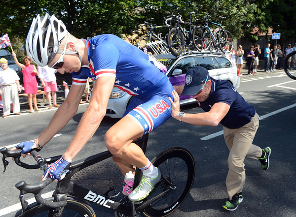 A USA mechanic helps Taylor Phinney after a lightening wheel-change...