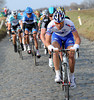 Dominique Rollin is leading a furious chase for FDJ on the cobblestones near Volkegem...