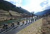 Sky is leading the peloton along the Gorge against a crystal clear river and bright sunshine...