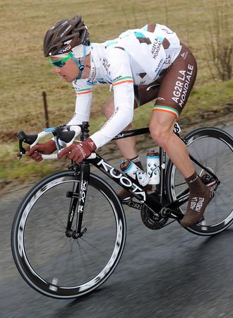 Nicholas Roche descends a hill on slippery roads...