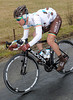 Nicholas Roche descends a hill on slippery roads...