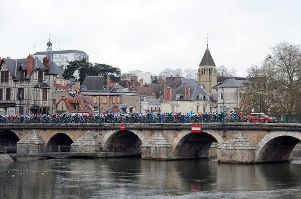 The peloton crosses the river in Vierzon at the start of stage three...