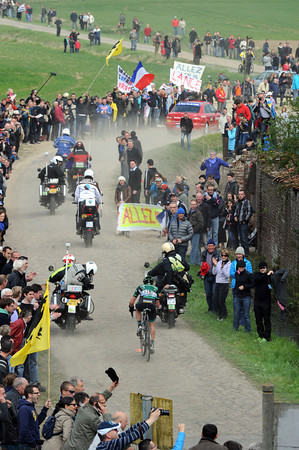 The solitary figure of Sebastian Turgot emerges on to the cobbles at Orchies...