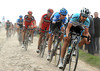 Boonen leads the chase himself, with Van Summeren and Hushovd on his wheel...