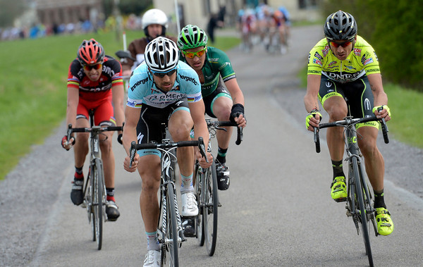 Boonen has created a four-man group with Pozzato, Turgot, and Ballan - but they're chasing Niki Terpstra who's soloed away on the cobbles...