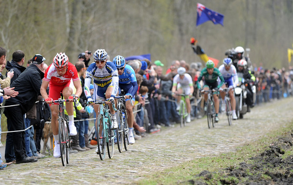 Aleksijs Saramotins is leading the escape through the Arenberg forest...