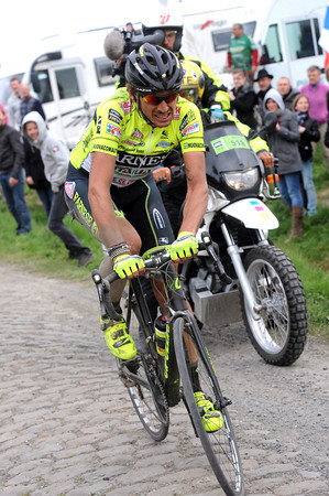 Pozzato has crashed on a corner, he looks stunned but continues for a while...