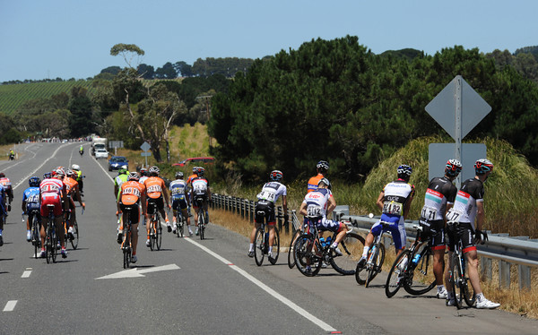 The peloton calls a mass halt for natural needs - allowing the escape a little longer out in front...