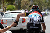 Hayden Roulston collects bottles for his new Radio-Shack-Nissan-Trek teamates...