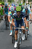 Alejandro Valverde leads a split in the escape as it starts the Col de la Croix-de-Fer, but some of the original escape will re-form...