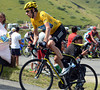 Bradley Wiggins uses his long legs to accelerate out of a bend - the real work will come later...
