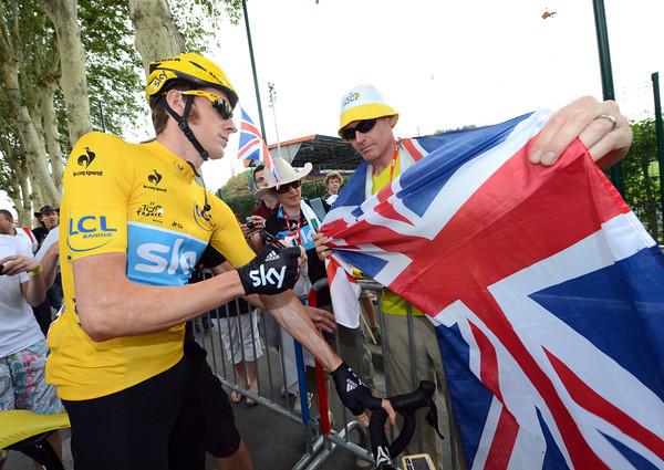 Happy days - a British fan gets a most prized autograph from Bradley Wiggins in Blagnac...