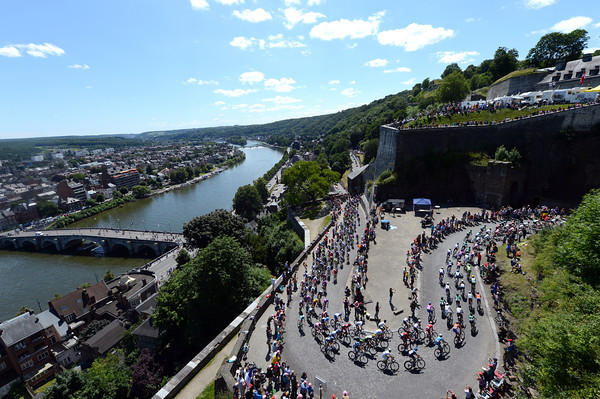 The peloton climbs into the Citadel above Namur and the River Meuse...