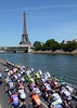 A fine sight - the peloton enters Paris alongside the River Seine and the Eiffel Tower...
