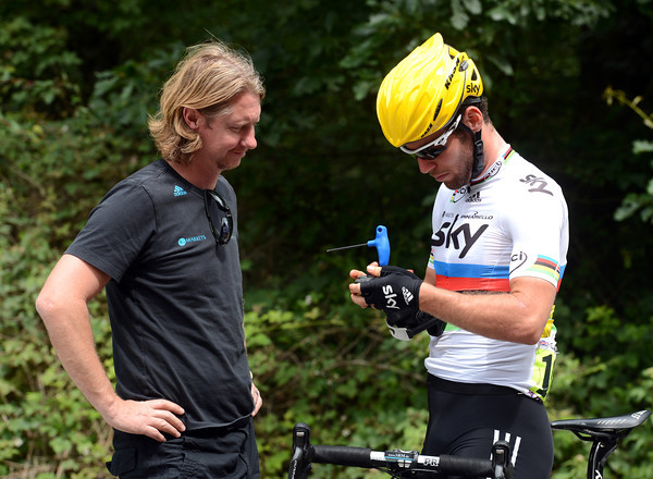 Mark Cavendish has trouble of another sort - his cleats need adjusting...