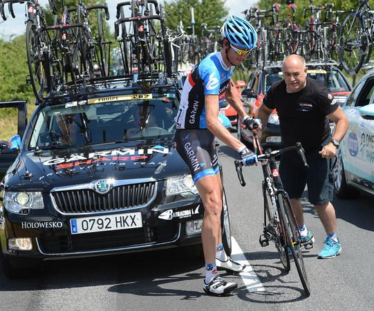 Johan Van Summeren needs his bike changed - Geoff Brown obliges...