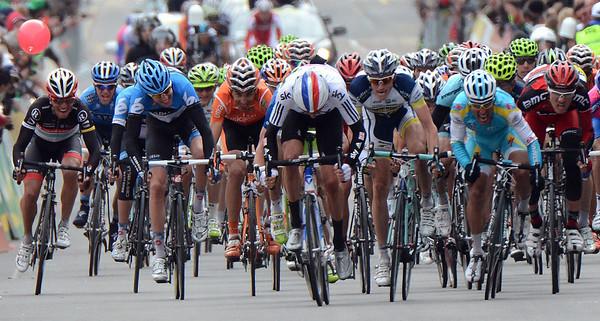 The sprint is on into La Chaux-de-Fonds - but a non-sprinter is leading it..!