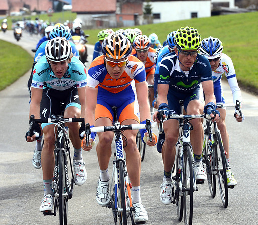 Velits, Slagter and Kiryienka lead a small group towards the finish, but Sky is coming from behind to force a regroupment...