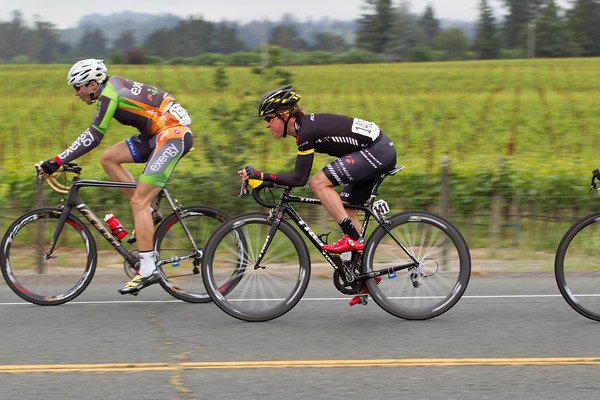 New Zealander Josh Atkins of the Bontrager LIVESTRONG U23 squad, passes vineyards as the escape extends its lead.