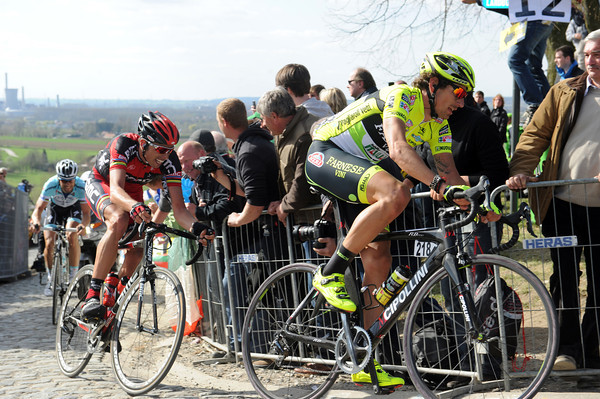 Pozzato has the strength to lead Ballan and Boonen over the Paterberg for the last time...